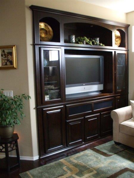 Add glass doors your entertainment center.