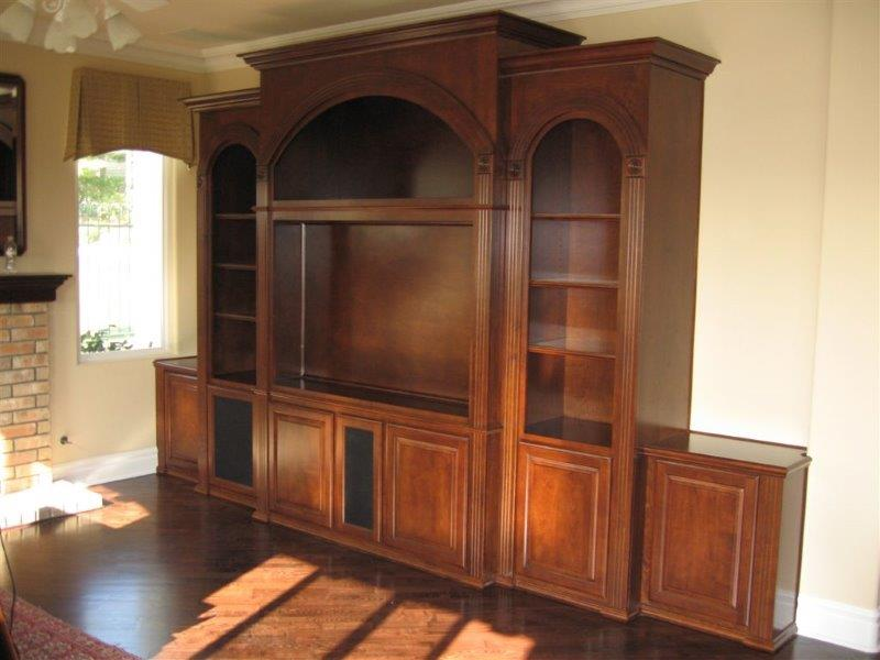 Not your basic TV stand. This entertainment center features fluted patriot arches. Fancy!