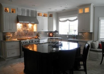 White kitchen cainets with stainless appliances