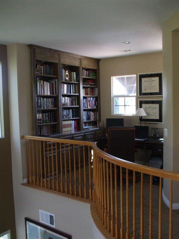 Built in desk and bookshelves in home office loft.