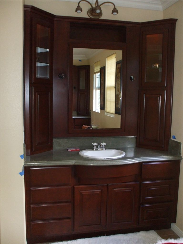 Get a new bathroom vanity woodwork creations for Custom bathroom cabinets