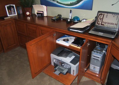 Put your printer on a pull out shelf in your home office