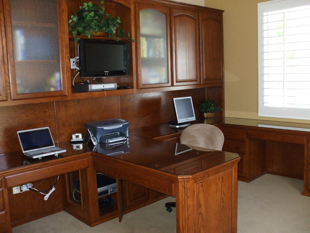 Custom home office furniture can provide maximum storage and organization Home Office Cabinets Built In Desks