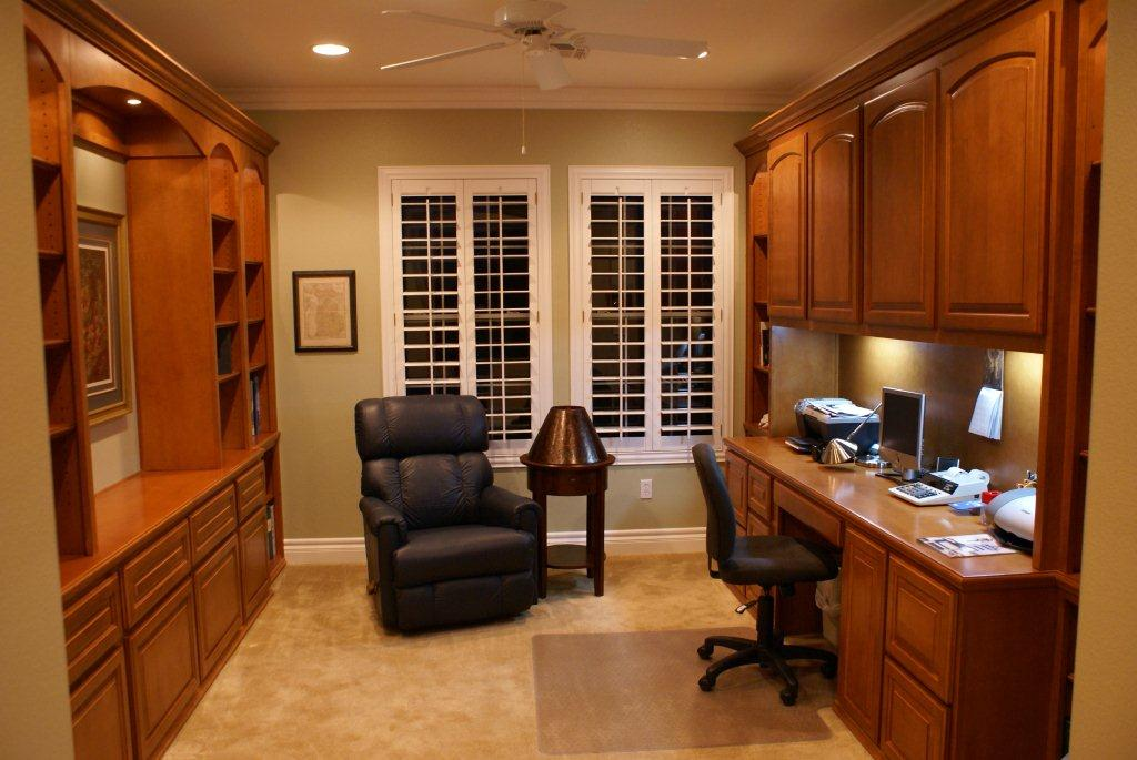 Put your printer on a pull out shelf in your home office. Custom Home Office Cabinets and Built In Desks