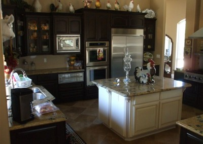 Light kitchen island with dark cabinetry